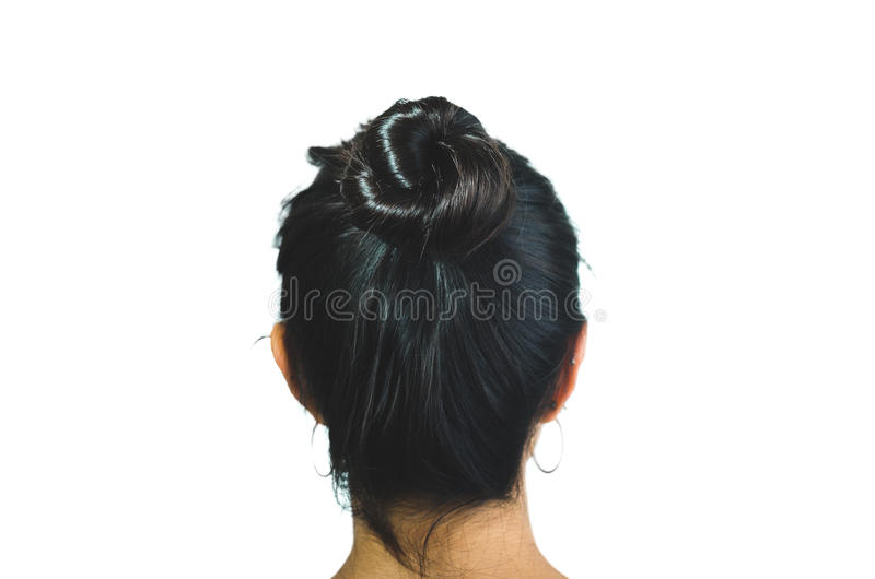 Rear view of brunette girl with hair bun royalty free stock image