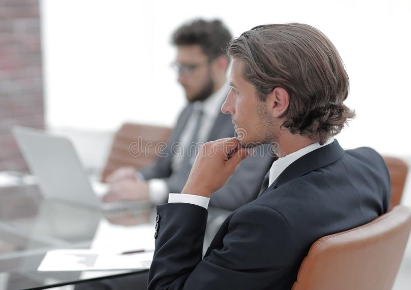 Rear View. Business Men Sitting In Front Of A Desk Stock Image ...