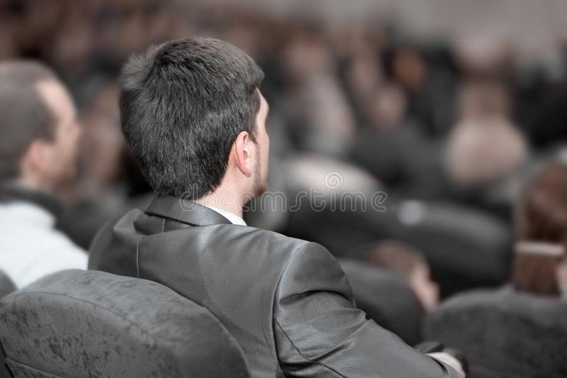 Rear view. business people listen to the speaker at the business presentation. stock photos