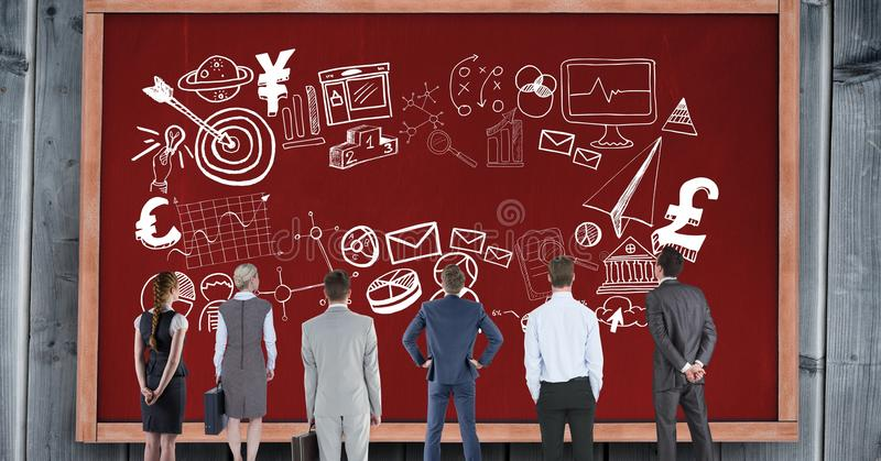 Rear view of business people looking at various symbols on red bulletin board royalty free stock photo