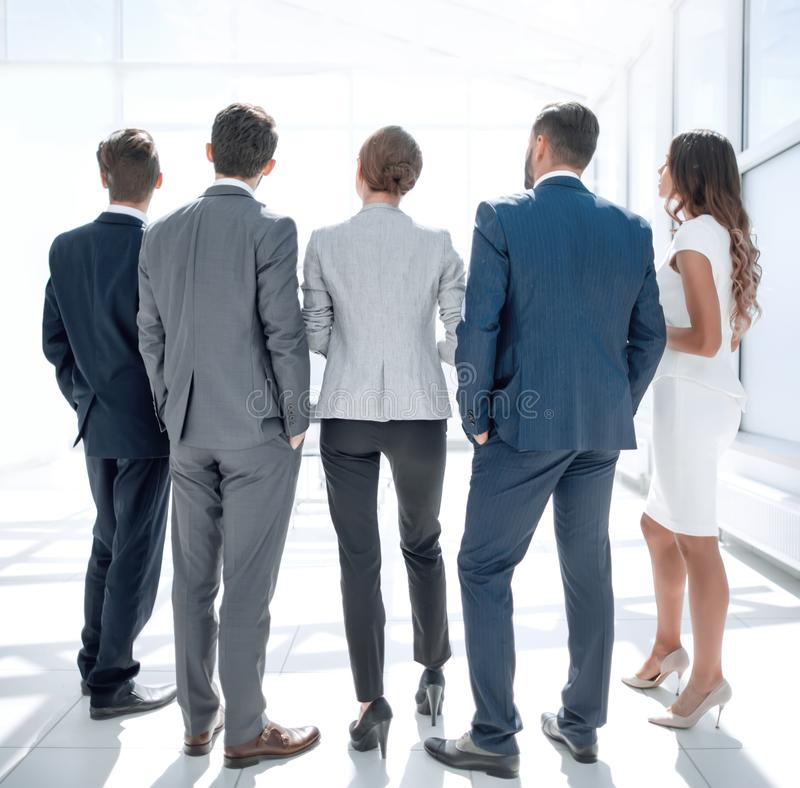 Rear view.business team looking at copy space royalty free stock image