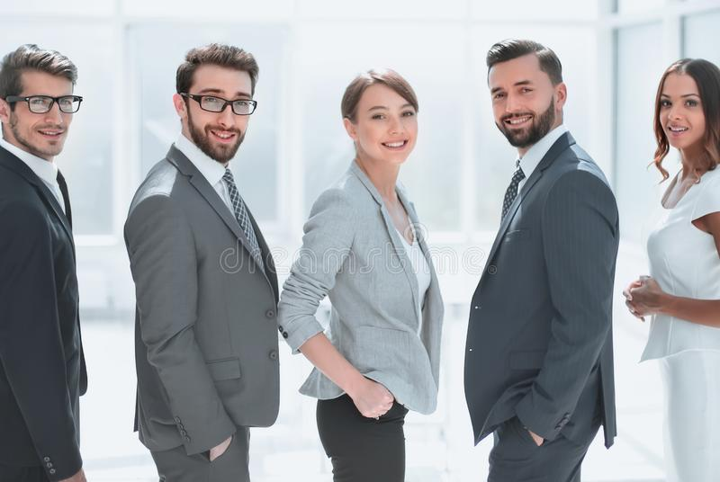 Rear view.business team smiling and looking at the camera royalty free stock photos