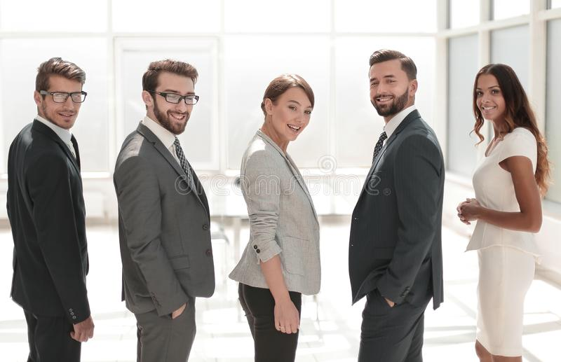Rear view.business team smiling and looking at the camera stock photos