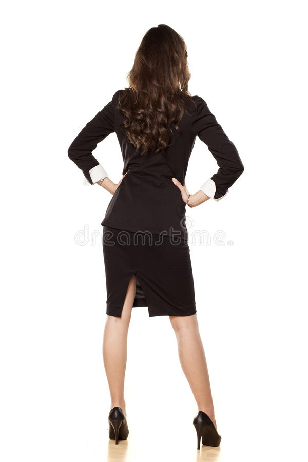 Rear view on the business woman royalty free stock photography