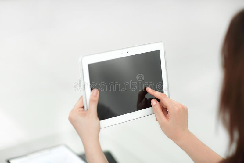 Rear view. business woman using digital tablet royalty free stock photo