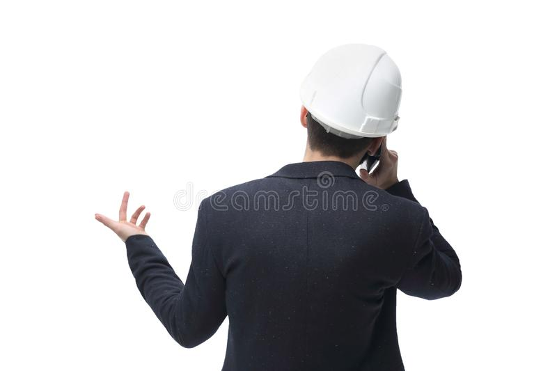 Rear view. businessman architect talking on mobile phone stock images