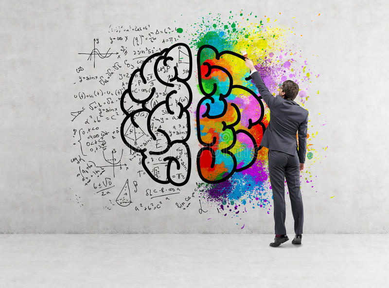 Rear view of businessman drawing colorful brain icon on concrete stock photo