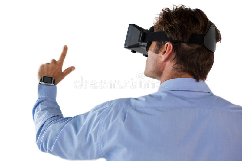 Rear view of businessman gesturing while using vr glasses. Against white backgrond royalty free stock image