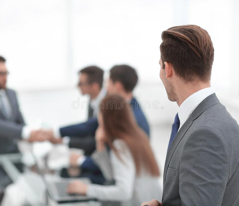 Rear view. businessman looking at workplace.  stock image