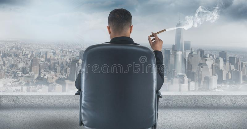 Download Rear View Of Businessman Sitting On Chair And Looking At City While Smoking Cigar Stock Photo - Image of blue, fume: 93224772