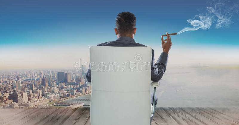 Download Rear View Of Businessman Sitting On Chair And Looking At Sea While Smoking Cigar Stock Photo - Image of adult, full: 93226284