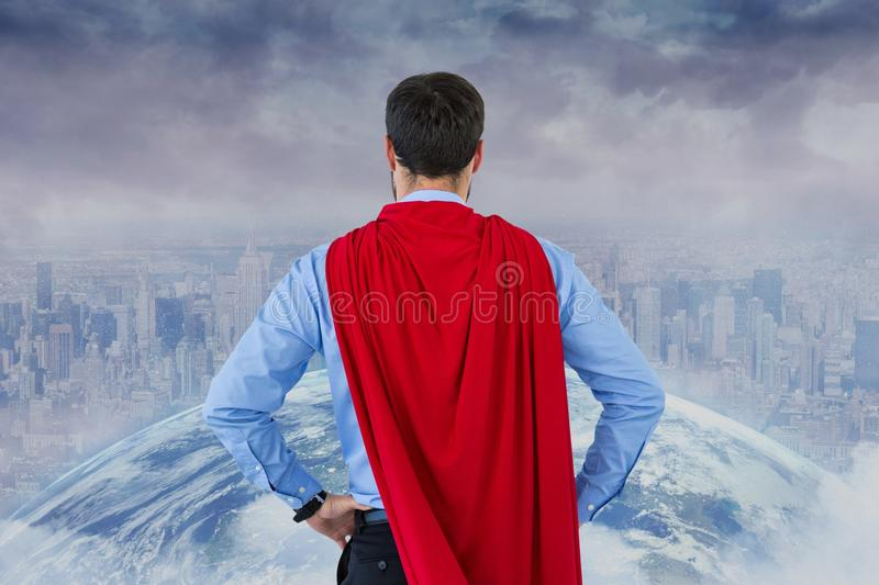 Rear view of businessman wearing super hero cape while looking at city and globe. Digital composite of Rear view of businessman wearing super hero cape while stock illustration