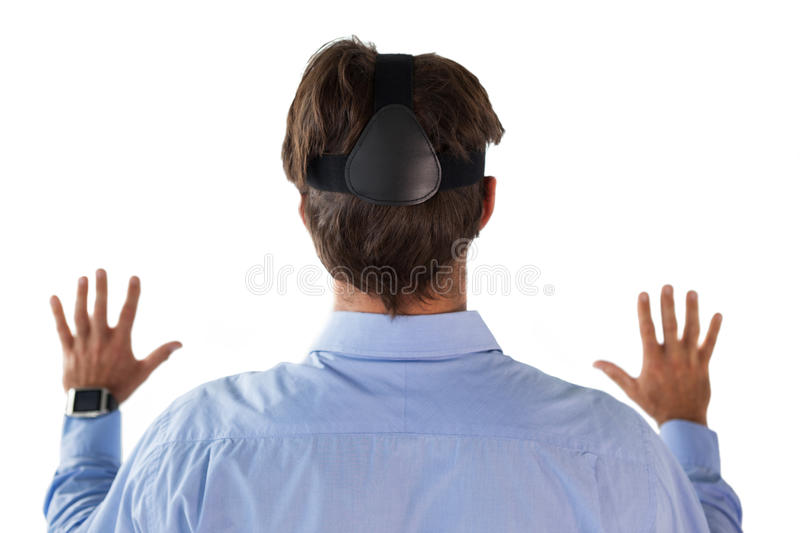 Rear view of businessman wearing vr glasses. Against white background stock photos
