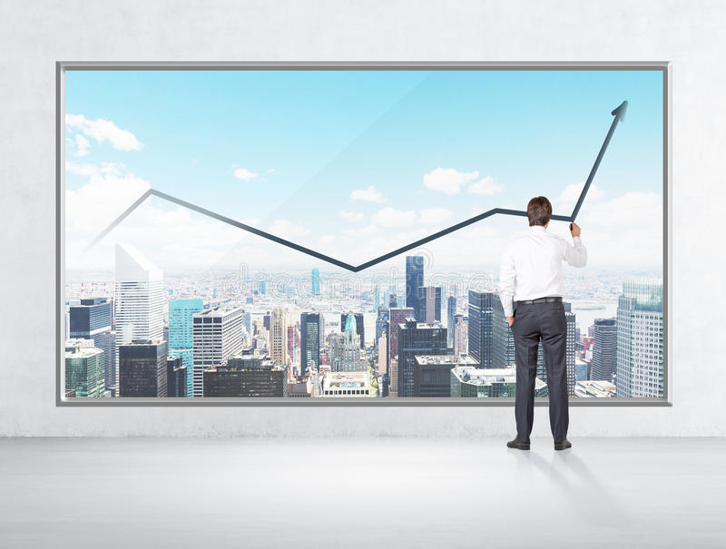 Rear view of businessman who is drawing a line chart on the New York panoramic poster. Concrete wall stock photography