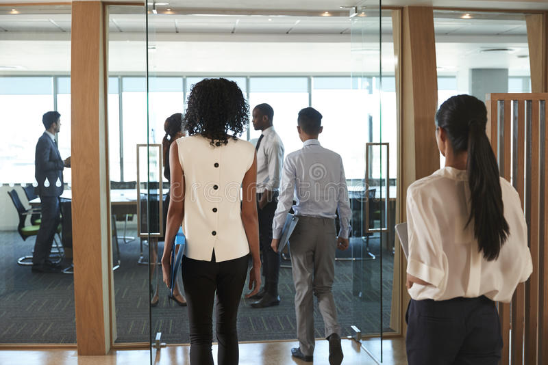 Rear View Of Businesspeople Entering Boardroom For Meeting royalty free stock photography