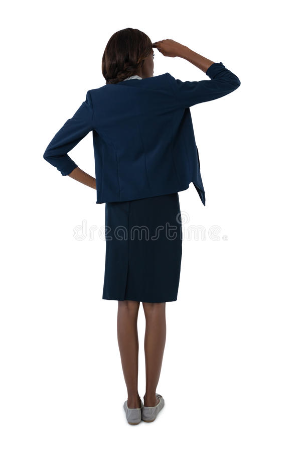 Rear view of businesswoman shielding eyes royalty free stock photography