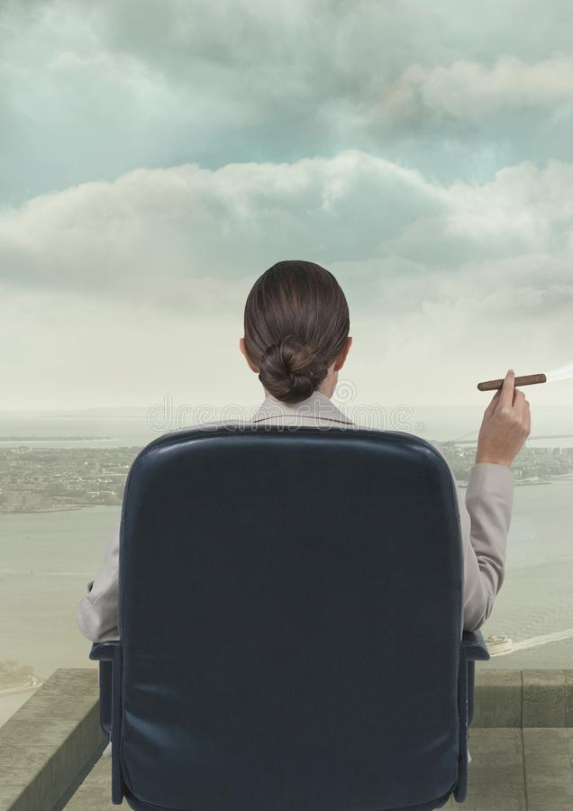 Rear view of businesswoman sitting in chair smoking cigarette against sky. Digital composite of Rear view of businesswoman sitting in chair smoking cigarette stock photography