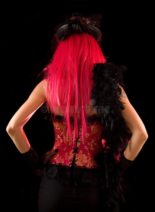 Rear view of cabaret girl in pink corset royalty free stock photo