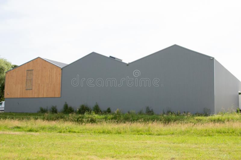 view of a company headquarters with a warehouse and offices royalty free stock photo