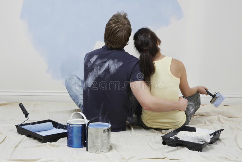 Rear View Of Couple Looking At Paint On Wall royalty free stock images