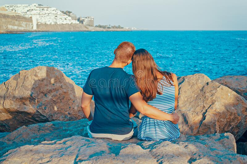 Rear View Of Couple Sitting On Beach Free Public Domain Cc0 Image