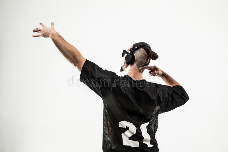 Rear view - creative rapper in the headphones and dark glasses p stock photography