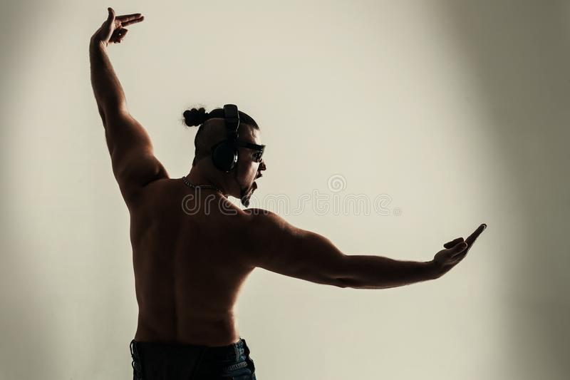 Rear view - creative rapper in the headphones and dark glasses p stock photos