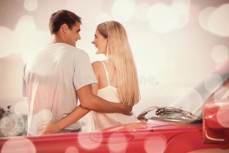 Rear view of cute couple hugging. While leaning against their cabriolet vector illustration
