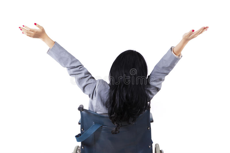 Rear view disabled woman on wheelchair stock photo