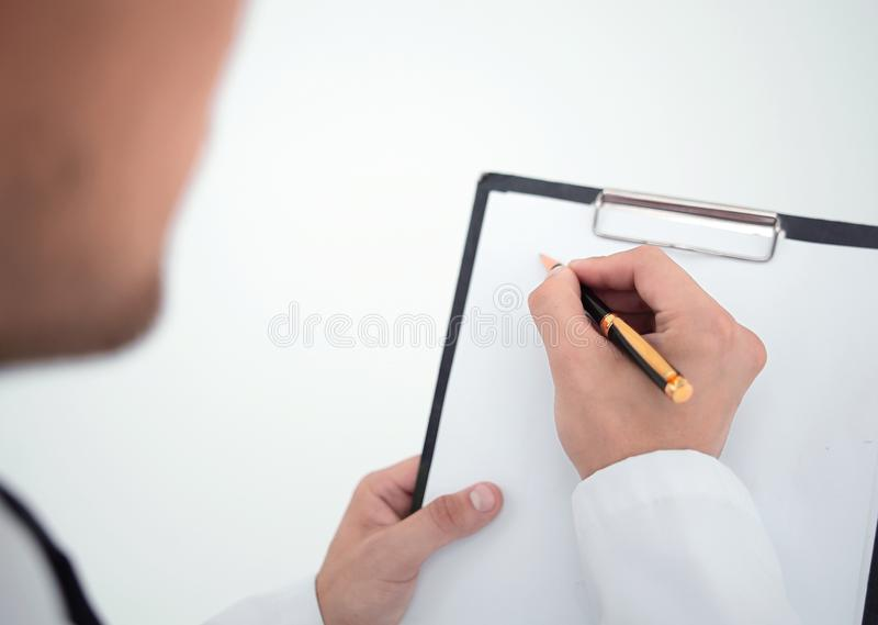 Rear view.the doctor writing the prescription royalty free stock photos
