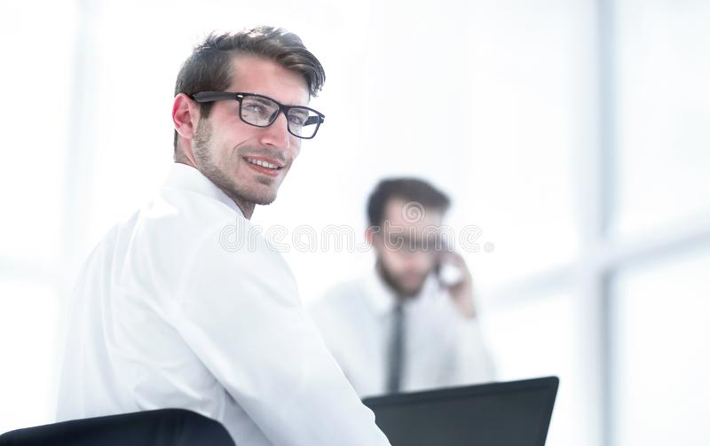 Rear view.employees sitting at the office Desk stock image