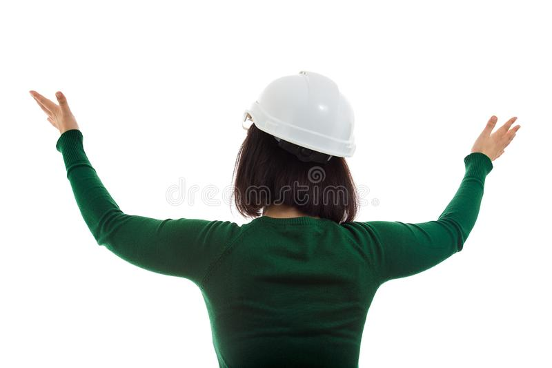 Rear view engineer hand raising stock images