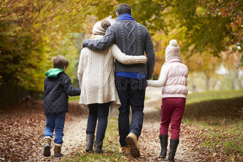 Rear View Of Family Walking Along Autumn Path stock photos
