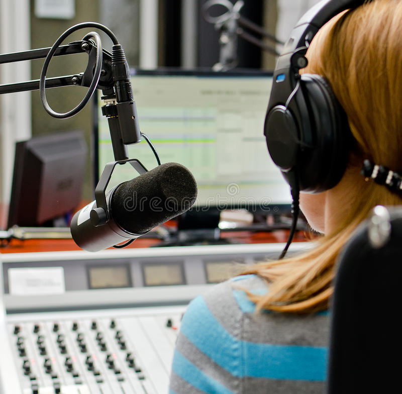 Download Rear View Of Female Dj Working Stock Photo - Image of earphones, female: 27021606