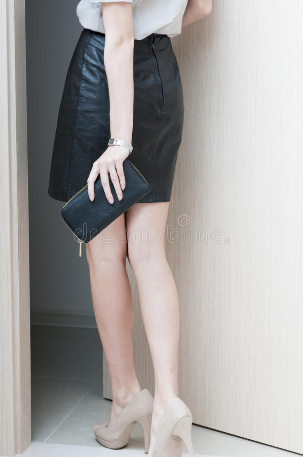 Rear view of female long legs shod in beige shoes. Rear view of female long legs shod in beige shoes with high heels stock photo