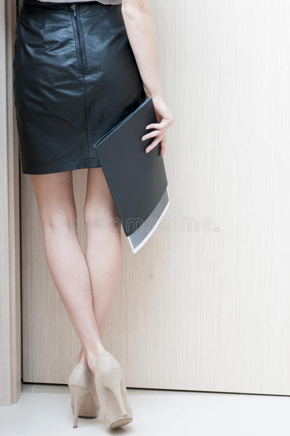 Rear view of female long legs shod in beige shoes. Rear view of female long legs shod in beige shoes with high heels stock images