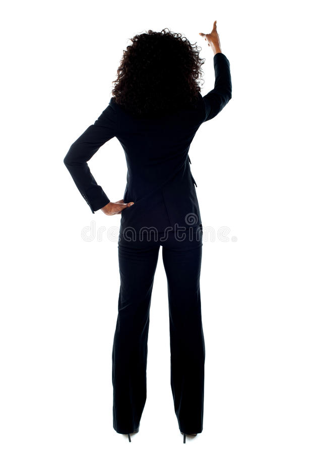 Download Rear View Of Female Pointing At Copy Space Stock Image - Image of corporate, businessperson: 25261551