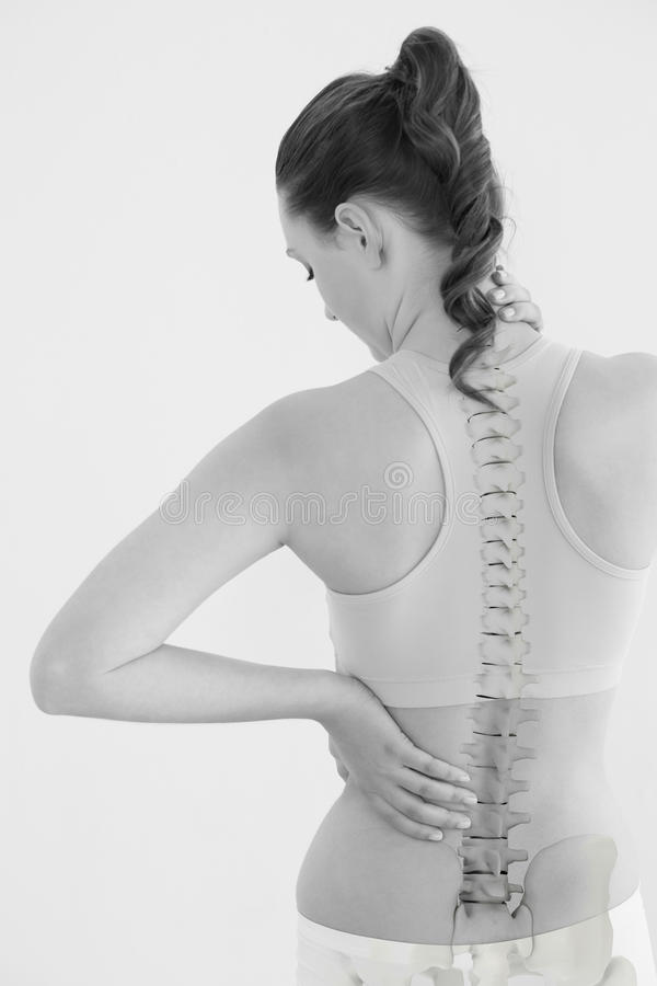 Rear view of female suffering from neck pain. Against white background stock images