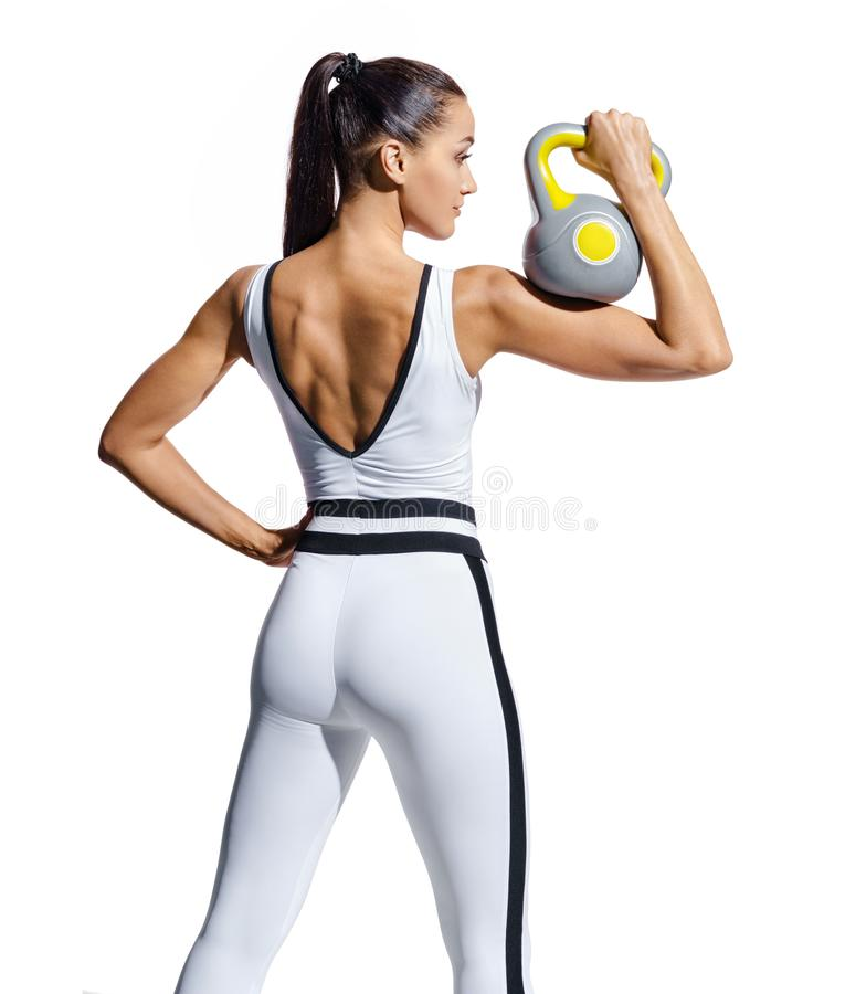 Rear view of fitness model with kettlebell isolated on white background. royalty free stock photo