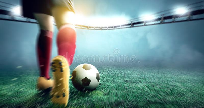 Rear view of football player woman kicking the ball on the football field. At stadium stock photos
