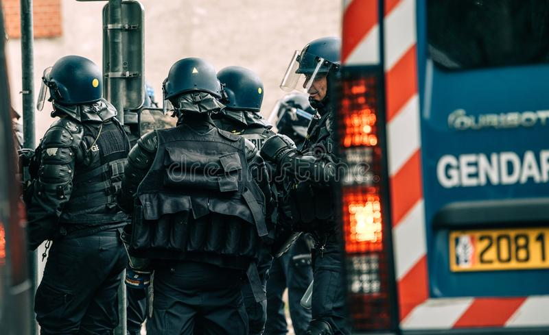 Rear view of French police officers gendarmes at yellow vests protest. Strasbourg, France - Apr 28, 2019: Rear view of French police officers gendarmes near royalty free stock image