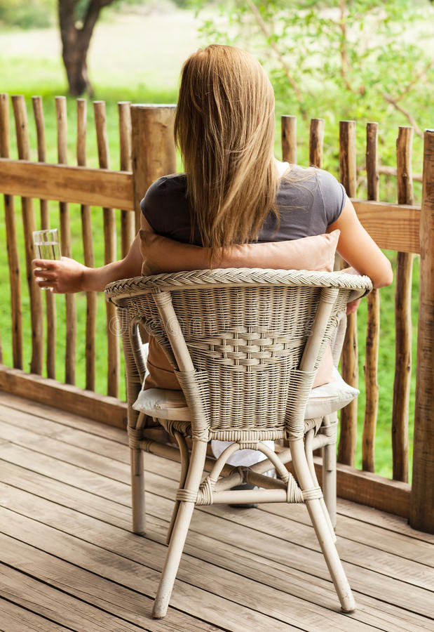 Download Rear View Of Girl Sitting On Veranda Stock Image - Image of holiday, beverage: 27714351
