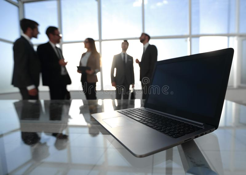 Rear view.a group of business people standing in the lobby of the business center royalty free stock photo