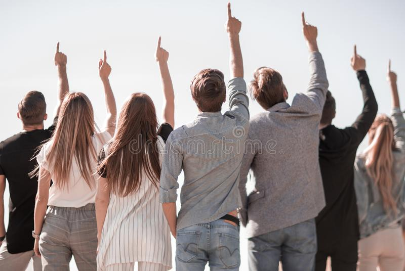 Rear view. a group of business youth pointing up at a copy space royalty free stock image