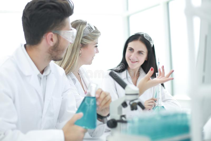 Rear view.a group of scientists working in a modern laboratory royalty free stock image