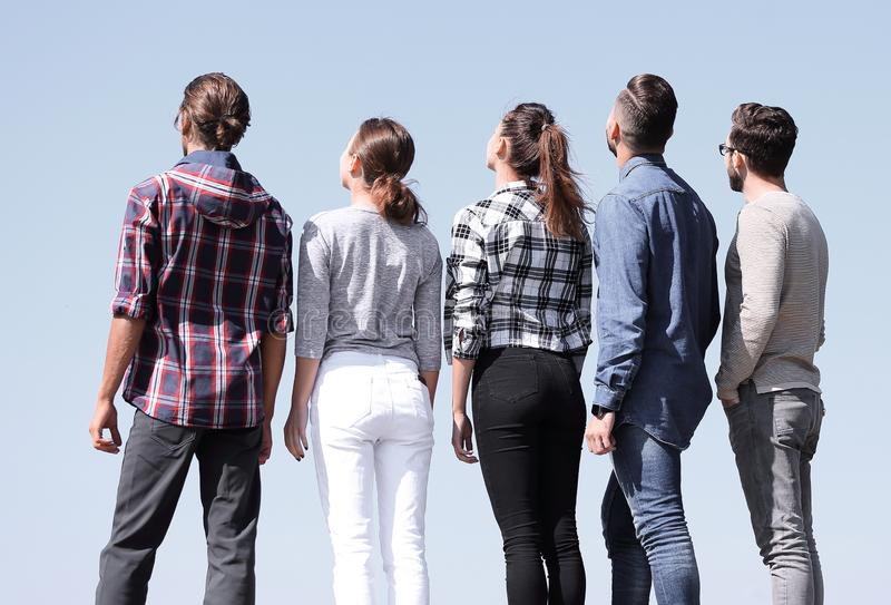 Rear view.a group of young people looking at copy space. The concept of perspectives stock images