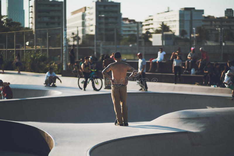 Rear view of guy in skate park stock photos