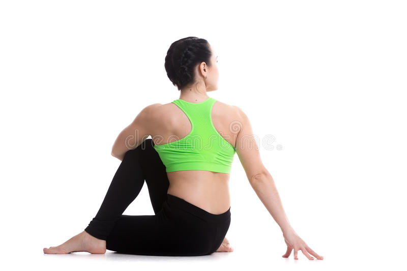 Rear view of Half lord of the fishes yoga asana royalty free stock photography