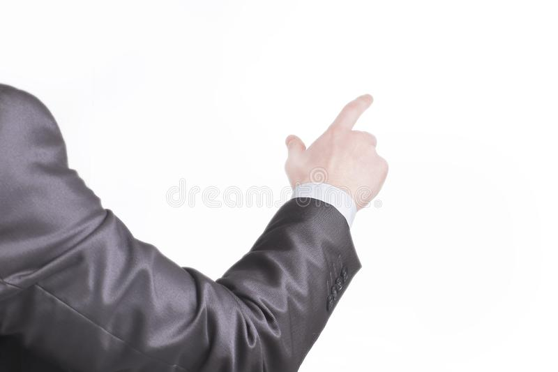 Rear view. hand of a businessman pointing at a copy space.  royalty free stock image
