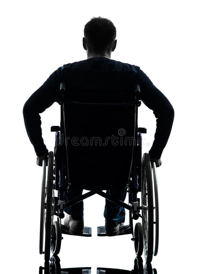 Rear view handicapped man in wheelchair silhouette. One handicapped man rear view in silhouette studio on white background stock photography